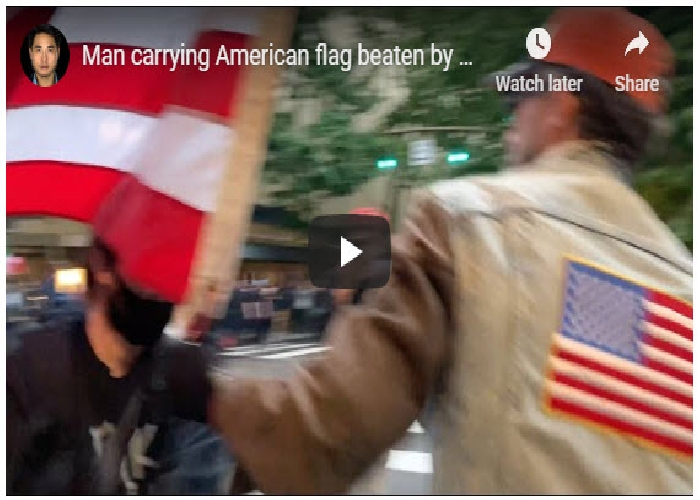 A Man Carrying An American Flag Assaulted By Extreme Minority